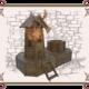 Деревянная мельница с клумбой